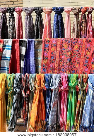 Women's scarves and palatines with oriental ornaments exposed for sale