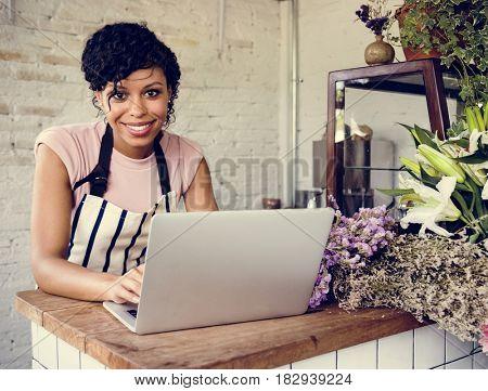 Woman Using Laptop Online Flower Shop