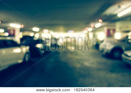Abstract Blurred In Car Parking Building Background.