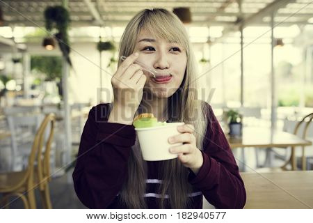 Woman eating melon ice-cream happiness