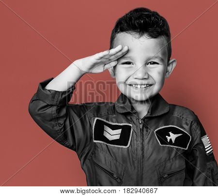 Little boy with pilot dream job salute and smiling