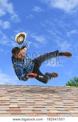 Senior man loosing balance on top of roof