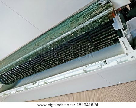 Dirty air-conditioner condenser cooling fins in the summer