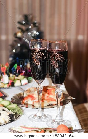 Glasses with red wine on a holiday table