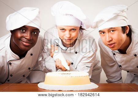 Studio shot of a team of confectioners
