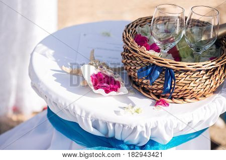 wedding in cyprus, bride and groom on a stone bridge in Agia Napa. arch and table for registration of marriage. The view of the sea. On the rock coast.