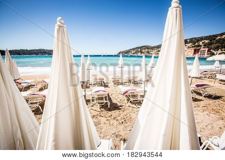 White parasols at the beach, Cote d'Azur French Riviera , France