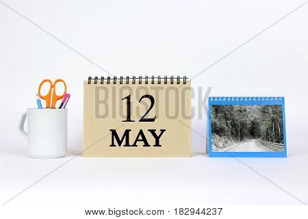 Deadline 12 May Calendar With White Background and Office.