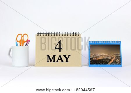Deadline 4 May Calendar With White Background and Office.