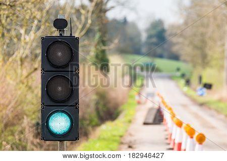 UK Motorway Roadworks Green Traffic Lights Cones.