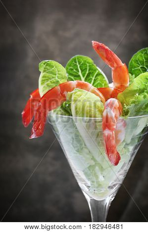 Shrimp cocktail with cos lettuce.