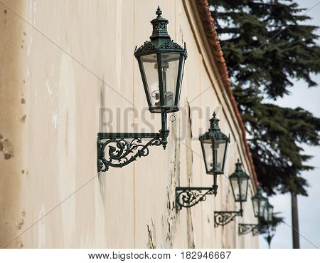 Beautiful photo of an old street lamp on the wall .