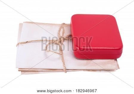 Old letters tied with a rope lying under the box isolated on white background