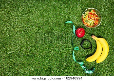 Sports nutrition of fruits and vegetables concept on a background of green grass