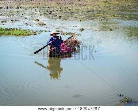 People Rowing Wooden Boat On The Lake