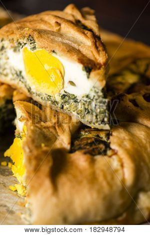 Baked Salty Pie With Eggs, Ricotta Cheese And Vegetables.