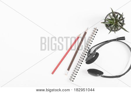 above top view of notebook pencil on white desk background. blank space for text can used for cover page presentation and web banner.