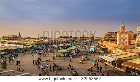 MARRAKESH, MOROCCO - APRIL 1,2017 - Evening at the Jemaa el-Fnaa square in Marrakesh medina. The Jemaa el-Fnaa is one of the best-known squares in Africa.