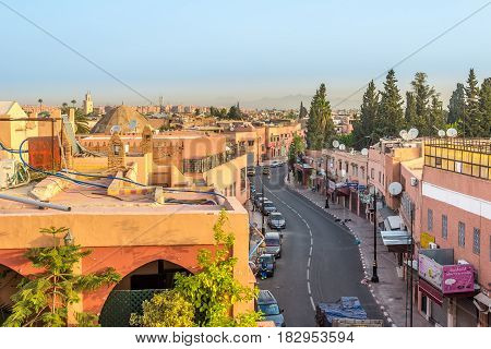 MARRAKESH, MOROCCO - APRIL 1,2017 - Over the marrakech streets paths and roofs. Marrakesh is the fourth largest city in the Morocco.