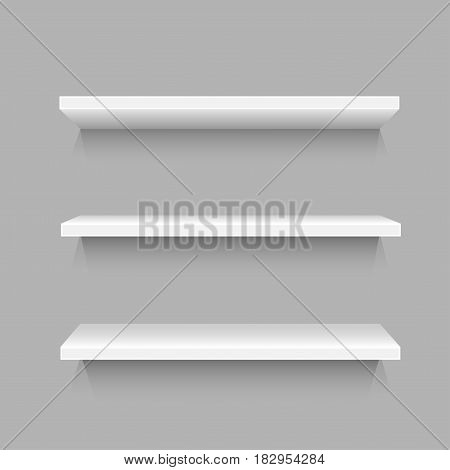 Three simple white shelves template with shadow for goods on gray background. Frame supermarket shop furniture design. Demonstration board