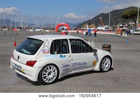 Chiavari Italy - April 22 2017 - 2nd T.A.M. (Tigullio Auto and Motorcycle) National Motor Show: Rally car show (here a Peugeot 106) in the circuit circuit of the fair.