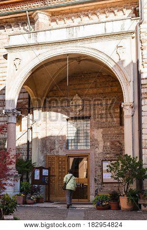 Tourist Near Entrance In Chiesa Di San Lorenzo