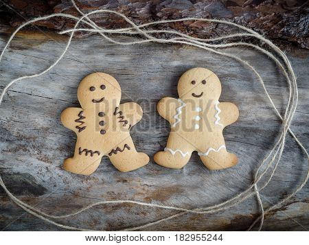 Happy Gingerbread People On Aged Wood