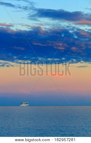 Beautiful seascape with vessel and sunset over Mediterranean sea