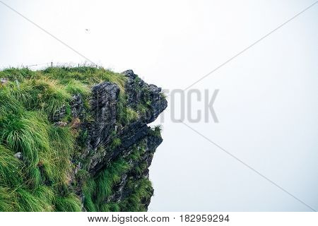 The Phu Che Fha Cliff with The mist background.