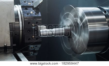Rotated industry mechanism - automatic for machine processing of metal, industrial background, close up