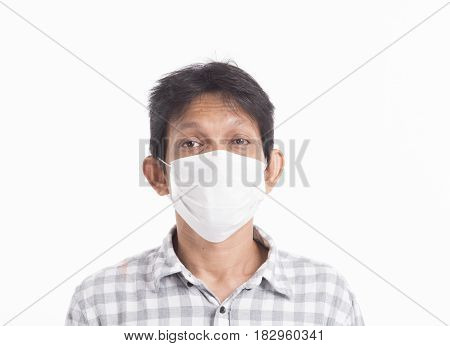 Asian adult male patient wearing mask on white background