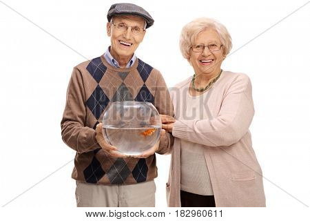 Joyful mature couple with a goldfish in a bowl isolated on white background