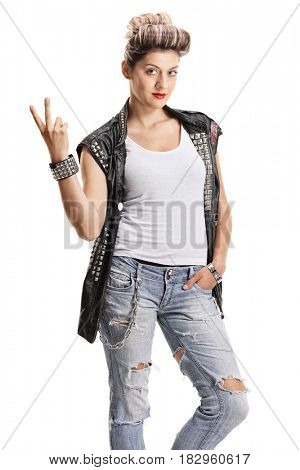 Punk girl making a peace sign and looking at the camera isolated on white background