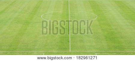 green soccer field with whie circle line