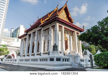 Chapel large white Thai temple location in middle of town.