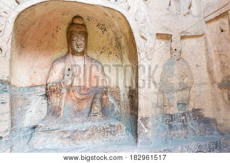 Shanxi, China -  Sept 17 2015: Budda Statues At Yungang Grottoes (unesco World Heritage Site). A Fam