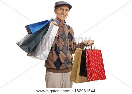 Senior with shopping bags looking at the camera and smiling isolated on white background