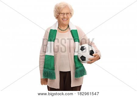 Happy elderly soccer fan with a scarf and a football isolated on white background