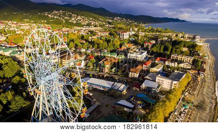 Aerial view on seashore resort area with big wheel