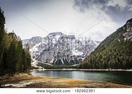 Spring view at Lago Braies, Pragser See Dolomites, Lake mountain landcape with Alps peak reflection , Italy