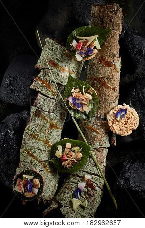 Leaf-Wrapped Bite-Size Appetizer on wood .(Thai Food)