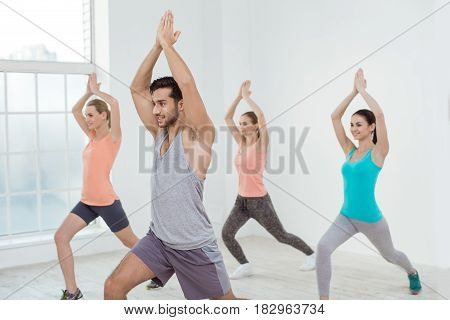 Young active group of people exercise together healthy lifestyle