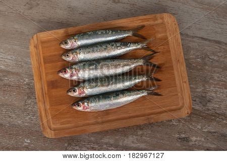 Fresh Sardines On The Wooden Carving Board.