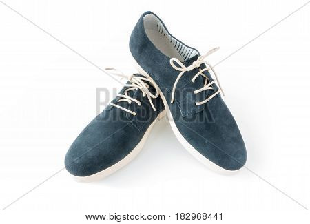 A pair of beautiful new modern casual summer shoes in blue suede with white shoe laces and soles for men. On white background with lots of copy space.