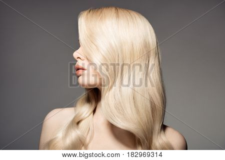Portrait Of Beautiful Young Blond Woman With Long Wavy Hair.