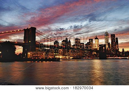 Manhattan skyline with Brooklyn Bridge at sunset - HDR image.