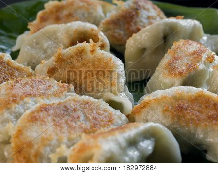 FRIED DUMPLINGS FILLED WITH MINCED CHICKEN AND SPRING ONION