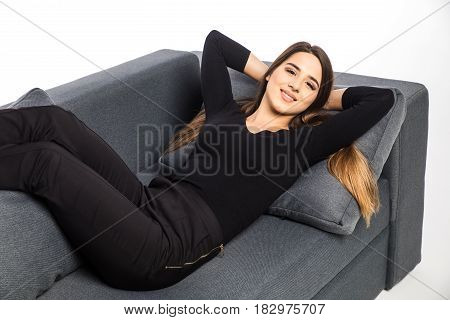 Portrait Of A Girl Relaxing And Smile On A Sofa On White Background