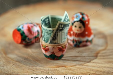 Russian Doll With Dollars Inside. Anti Crisis Money Box. Matrioska Bank.