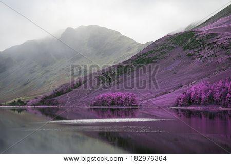 Stuning Aternate Color Autumn Fall Landscape Image Of Lake Buttermere In Lake District England